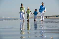 photo of family on the beach