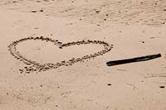 photo of heart drawn in the sand